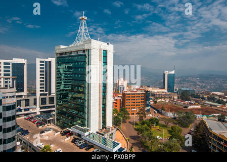 Kigali, Rwanda - September 21, 2018: a wide view looking down on the city centre with Pension Plaza looming in the foreground and Kigali City Tower in - Stock Photo