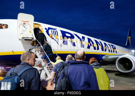 Passengers board a Ryanair aircraft for a flight from Glasgow Prestwick airport. - Stock Photo