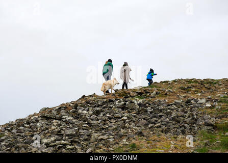 People walking on Loughcrew megalithic tomb