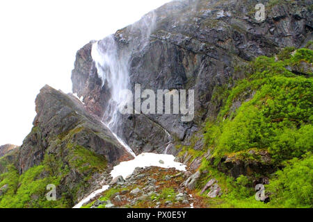 Water falls in Western Brook Pond, Gros Morne National Park, Newfoundland, Canada, Tabletop Mountains, inland fjiord - Stock Photo