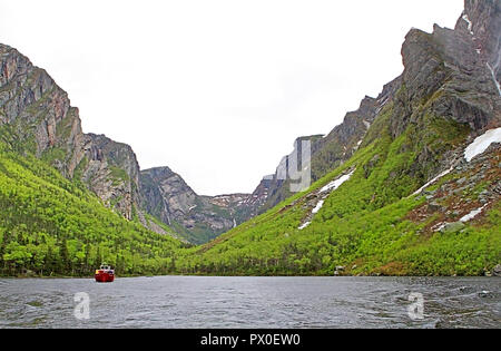 Tour boat in Western Brook Pond, Gros Morne National Park, Newfoundland, Canada, Tabletop Mountains, inland fjiord - Stock Photo