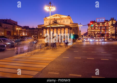 Moscow, Russia - August 1, 2108: Crossroads with a pedestrian crossing at the Bolshoi Theater in Moscow. Night city life in Russia - Stock Photo