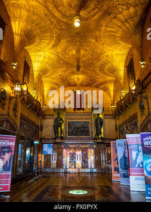 Fan vaulted ceiling and Gothic style foyer of the State Theatre featuring bronze statues Market Street Sydney NSW Australia. - Stock Photo