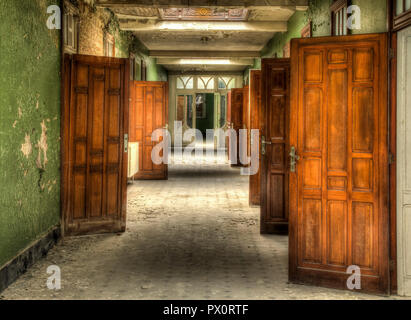 Interior view with beautiful wooden doors in an abandoned swimming pool in Belgium. - Stock Photo