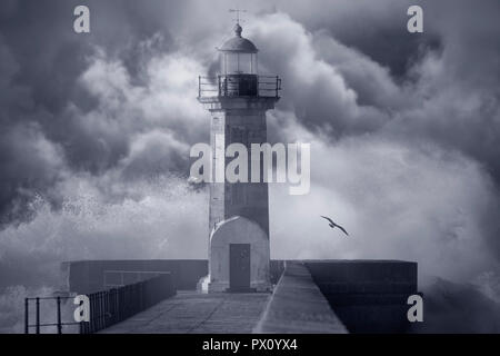 Old lighthouse against an enhanced cloudy stormy sky. Converted Black and white. Tone blue. - Stock Photo