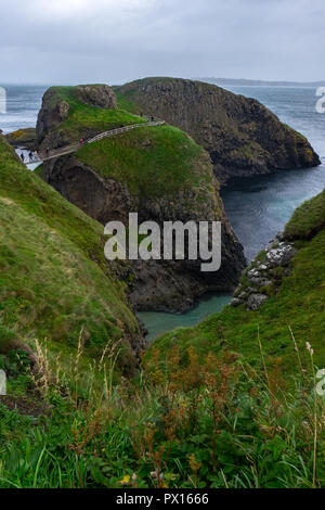 Carrick-a-Rede Rope Bridge is a famous rope bridge near Ballintoy in County Antrim, Northern Ireland. - Stock Photo