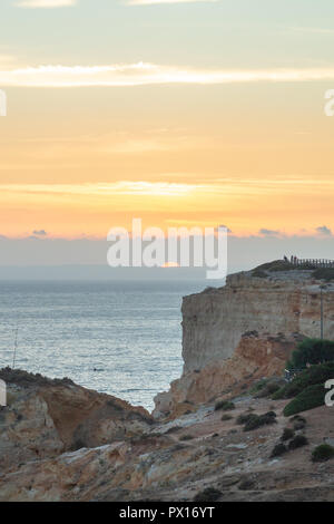 Summer sunset by Algar Seco. The place which is well know of it's unique rock formations on the Algarve, Portugal. - Stock Photo
