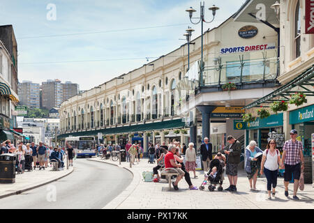 21 May 2018: Torquay, Devon, UK - Shopping in Fleet Street, with the Fleet Walk shopping mall, on a warm spring day. - Stock Photo