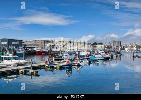 2 June 2018: Plymouth, Devon, UK - Plymouth Harbour, with a view towards the fish quays and Plymouth Fisheries on the left. - Stock Photo