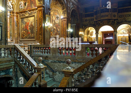 ROME, ITALY - SEPTEMBER 26 2018: Basilica of Saint Sylvester the First , the baroque  interior with the confessio or devotional crypt below the altar - Stock Photo