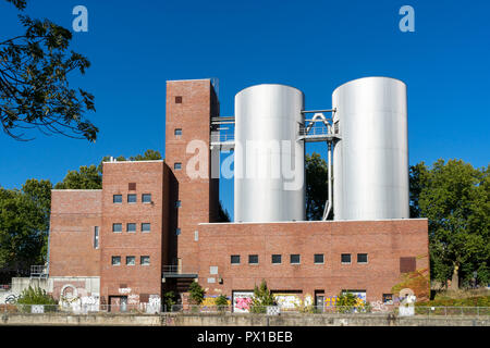 Berlin, Germany - September 30, 2018: View on Charlottenburg Power Plant (Kraftwerk Charlottenburg) from the opposite side of the river with a couple  - Stock Photo