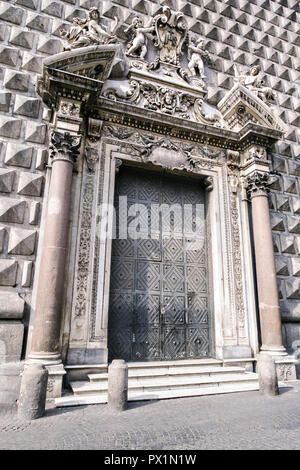 The Church of Gesu Nuovoin Naples, southern Italy. The Church of Gesu Nuovo was originally a palace built in 1470 for Roberto Sanseverino, Prince of Salerno. The unusual building is faced with with rustic ashlar diamond projections. - Stock Photo