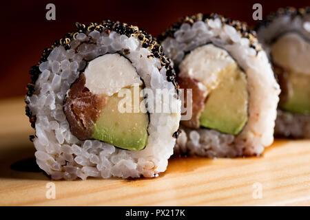 Sushi roll sushi with prawn, avocado, cream cheese, sesame. Sushi menu. - Stock Photo