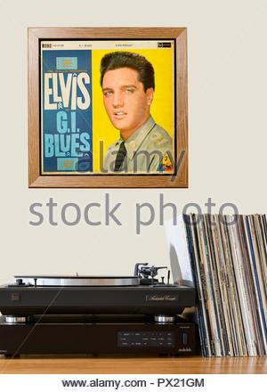 Record player and framed album cover Elvis Presley album G I Blues, England - Stock Photo