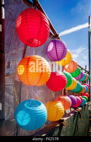 Afternoon sun shines through a colorful display of Chinese paper lanterns at an Asian American cultural festival in Costa Mesa, CA.  (Photo by Spencer Grant) - Stock Photo