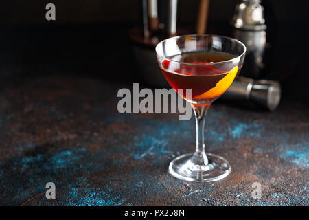 Fall whiskey cocktail made with rye, sweet vermouth, and bitters served with orange zest - Stock Photo