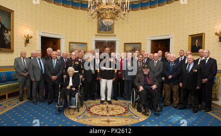 Retired U.S. Marine Corps Sgt. Maj. John L. Canley, the 300th Marine Medal of Honor recipient, poses with 1st Battalion, 1st Marines at the White House in Washington, D.C., Oct. 17, 2018. From Jan. 31, to Feb. 6 1968 in the Republic of Vietnam, Canley, the company gunnery sergeant assigned to Alpha Company, 1st Battalion, 1st Marines, took command of the company, led multiple attacks against enemy-fortified positions, rushed across fire-swept terrain despite his own wounds and carried wounded Marines into Hue City, including his commanding officer, to relieve friendly forces who were surrounde