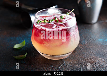 Fall seasonal refreshing cocktail with pomegranate syrup - Stock Photo