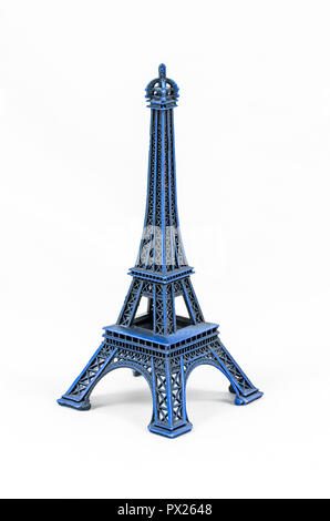 Close up shot of a blue miniature model of the Eiffel Tower isolated on a white background - Stock Photo