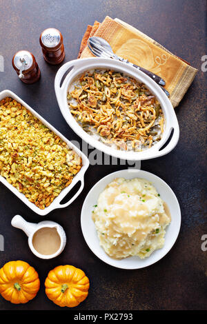 All traditional Thanksgiving side dishes, mashed potatoes, green beans and stuffing - Stock Photo