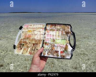 Fly box filled with flies for fly fishing in shallow water for bonefish and permit. - Stock Photo