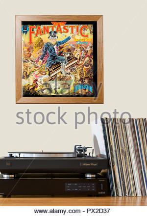 Record player and framed album cover Elton John 1974 album Captain Fantastic and the Brown Dirt Cowboy, England - Stock Photo
