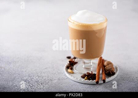 Spiced chai latte with milk foam, seasonal fall drink - Stock Photo