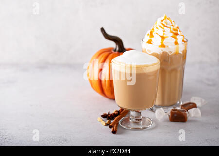 Pumpkin spice latte and caramel iced coffee, fall seasonal drinks - Stock Photo