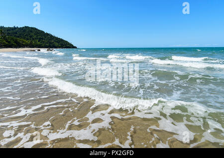 Gentle waves rolling on the beach at Etty Bay, Cassowary Coast, Far North Queensland, FNQ, QLD, Australia - Stock Photo