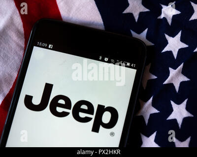 Jeep  logo seen displayed on smart phone/ Jeep is a brand of American automobiles that is a division of FCA US LLC, a wholly owned subsidiary of the Italian-American corporation Fiat Chrysler Automobiles. - Stock Photo