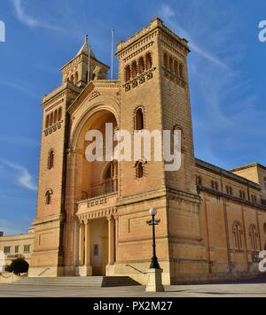 White Stork, Ciconia ciconia, migrating over the Maltese Islands. Big bird balancing resting on top of a tall Catholic Church bell tower, Birzebbuga. - Stock Photo