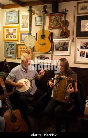 Traditional Scottish folk music band in Port Charlotte Hotel bar, in Port Charlotte, Scotland, on 14 October 2018. - Stock Photo