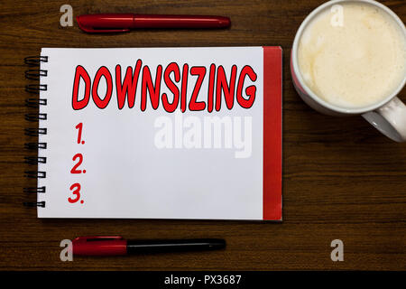 Handwriting text writing Downsizing. Concept meaning Make a company smaller by shedding staff Expenses reduction Open notebook markers inspiration com - Stock Photo