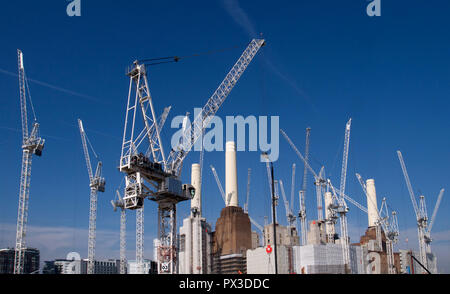 Multiple cranes on the Battersea Power Station development, London - Stock Photo