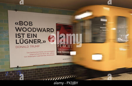 Berlin, Germany. 19th Oct, 2018. An advertising poster for the book about the US president hangs on the wall of a subway station. Credit: Jörg Carstensen/dpa/Alamy Live News - Stock Photo