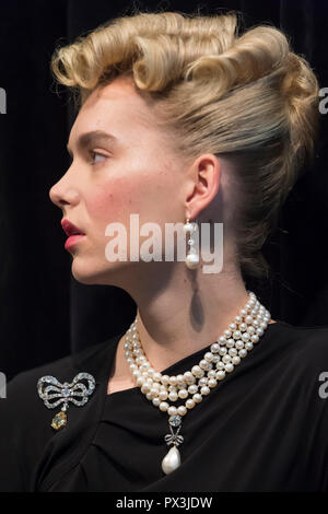 London, UK.  19 October 2018. A model wears Marie Antoinette's jewels (L to R) diamond brooch, second half of the 18th century (Est. USD 50k-80k), natural pearl and diamond necklace three rows of 116 graduated pearls (Est USD200k-300k), natural pearl and diamond necklace (Est USD40k-70k), 'Queen Marie Antoinette's Pearl', natural pearl and diamond pendant 18th century set (Est USD1m-2m), and pair of natural and pearl diamond pendant earrings, late 18th century (Est USD200k-300k). Credit: Stephen Chung/Alamy Live News - Stock Photo