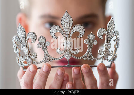 London, UK.  19 October 2018. A model presents diamond tiara, Hübner, circa 1912, of fleur de lys design, with diamonds (USD350k-550k) from Charles X, King of France.  Led by a breath-taking group of jewels which once belonged to Marie Antoinette, queen of France, the collection known as the Royal Jewels from the Bourbon-Parma Family will be offered for sale at Sotheby's, Geneva. Credit: Stephen Chung/Alamy Live News - Stock Photo