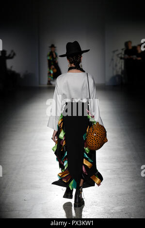 V&A, London, UK. 19 October 2018. A retrospective catwalk show at the museum, Fashion in Motion: Carla Fernández, is staged in the dramatic setting of the museum's Raphael Gallery, the show sees models wearing designs by Mexican designer, Carla Fernández. She presents her work inspired by the rich textile heritage of Mexico's indigenous communities in her debut UK show. Fashion in Motion also coincides with the critically acclaimed exhibition on Frida Kahlo. Credit: Malcolm Park/Alamy Live News. - Stock Photo