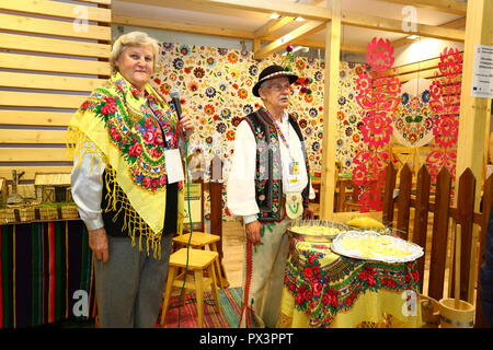 Nadarzyn, Poland, 19th October 2018: Mazovian promotion stand with traditional dress at World Travel Show. ©Jake Ratz/Alamy Live News - Stock Photo