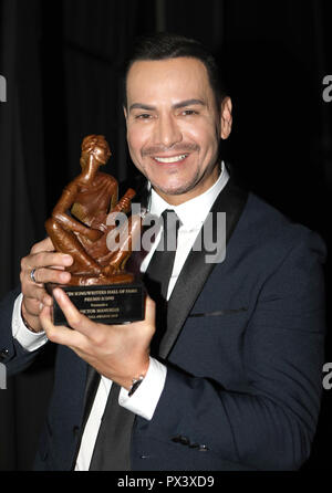 Miami, FL, USA. 18th Oct, 2018. Victor Manuelle at the 6th Anniversary Induction Gala for La Musa Awards at The James L. Knight Center in Miami, Florida on October 18, 2018. Credit: Majo Grossi/Media Punch/Alamy Live News - Stock Photo