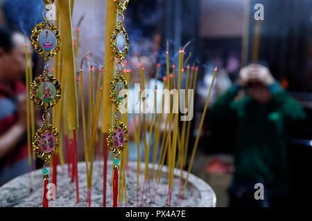 Thien Hung buddhist temple.  Close-up of incense sticks burning. Ho Chi Minh City. Vietnam. - Stock Photo