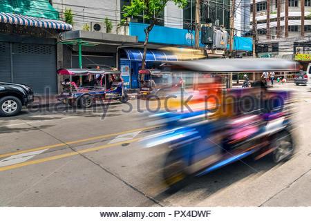 Tuk Tuk three-wheeler taxi, Chinatown, Bangkok, Thailand - Stock Photo