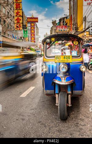 Tuk Tuk three-wheeler taxi, Yaowarat Road, Chinatown, Bangkok, Thailand - Stock Photo