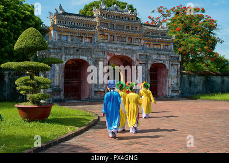 Vietnamese extras walk through West Gate, Chuong Duc, Imperial Palace Hoang Thanh, Hue, Vietnam - Stock Photo