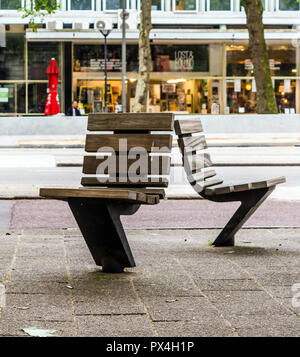 Practical and comfortable street furniture in Rotterdam, Netherlands. All these chairs can rotate on their axis and could be turned to any direction. - Stock Photo