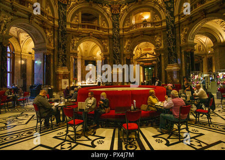 Tourists and visitors relaxing and drinking inside the ancient bar of Kunsthistorisches Museum. The Musem was opened in 1891 - Stock Photo