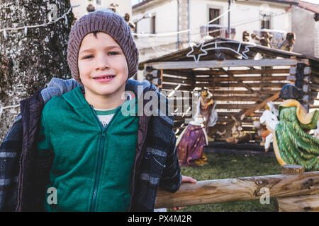 boy with Christmas nativity scene - Stock Photo