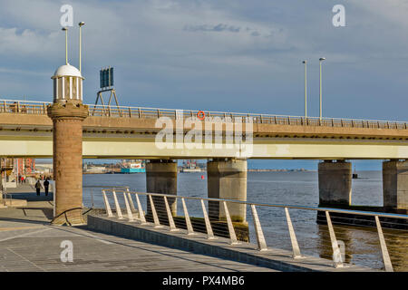 TAY ROAD BRIDGE ON THE DUNDEE SIDE OF THE TAY ESTUARY LOOKING DOWN THE WATERFRONT - Stock Photo