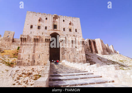Aleppo, Aleppo Governorate, Syria : People at the entrance of the Citadel of Aleppo, a large medieval fortified palace in the centre of the old city.  - Stock Photo