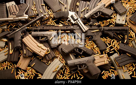 Assault rifle and handguns with ammunition and high capacity magazines. - Stock Photo